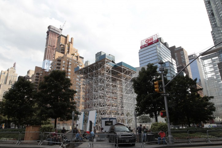 """Scaffolding surrounds the statue of Christopher Columbus, Tuesday, Aug. 21, 2012 in New York's Columbus circle. Japanese artist Tatzu Nishi is constructing """"Discovering Columbus,"""" a contemporary living room around a statue of Columbus as a way to intimately engage the public with the iconic figure which looms six stories above a busy intersection of mid-Manhattan. But some Italian-Americans say the art project makes a mockery of the great explorer and trivializes history. (AP Photo/Mary Altaffer)"""