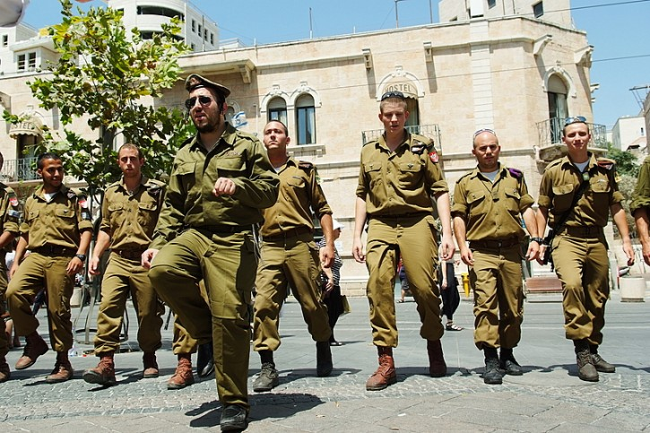Schmeltzer shot footage for the video several days ago in Jerusalem's Kikar Tziyon, clad in army fatigues, with members of the Nachal Chareidi's Netzach Yehuda division.Photo credit is Mendy Hechtman