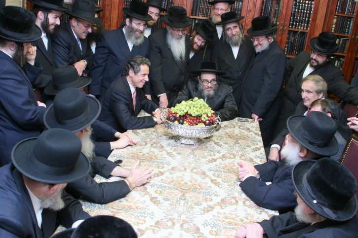 In this Oct 3 2010 photo, NY Gov. Cuomo in Williasmburg section of Brooklyn meeting with Pupa Rebbe Rabbi Yaakov Chizkiah Greenwald, at the right is seen Vito Lopez, the embattled Brooklyn Democratic Party chairman