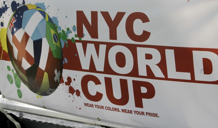 A banner for the New York City World Cup is seen in a field in Harlem, New York on Saturday Aug. 4, 2012. The New York tournament, with 20 teams representing countries worldwide, gives more than 200 soccer enthusiasts a chance to play with an international scope without leaving the city, every Saturday for 2 months in the summer.  (AP Photo/Fay Abuelgasim)