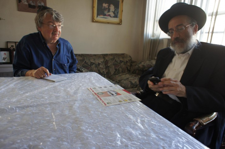 NY Times reporter Joseph Berger in interview with  Yitzchok Fleischer, the founder and executive director of the Bikur Cholim D'Bobov. Photo: Alexander Rapaport