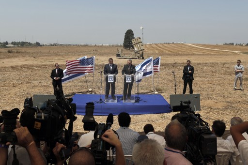 FILE - U.S. Secretary of Defense Leon Panetta, left, and Israel's Defense Minister Ehud Barak deliver statements to the media during a visit to an Iron Dome rocket defense shield battery, seen back, in the coastal city of Ashkelon, southern Israel, Wednesday, Aug. 1, 2012. FLASH90