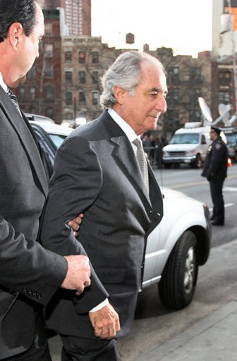 Bernard Madoff arrived at a federal court in New York March 12, 2009 where he pleaded guilty to charges that he engineered one of the largest investment scams in U.S. history. (AP Photo/Mary Altaffer)