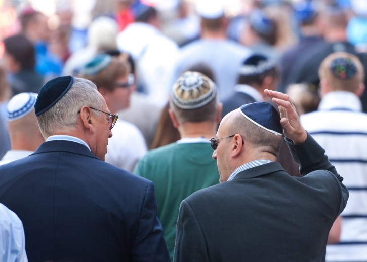 People walk along the streets wearing kippahs, or Jewish skull-cap, during a Kippah Flash mob in Berlin, Germany, 01 September 2012. The flash mob was initiated as a reaction to a recent brutal attack in which a 53-year-old rabbi was punched in the head and insulted with anti-Semitic slurs by four young men.  EPA/SEBASTIAN KAHNERT