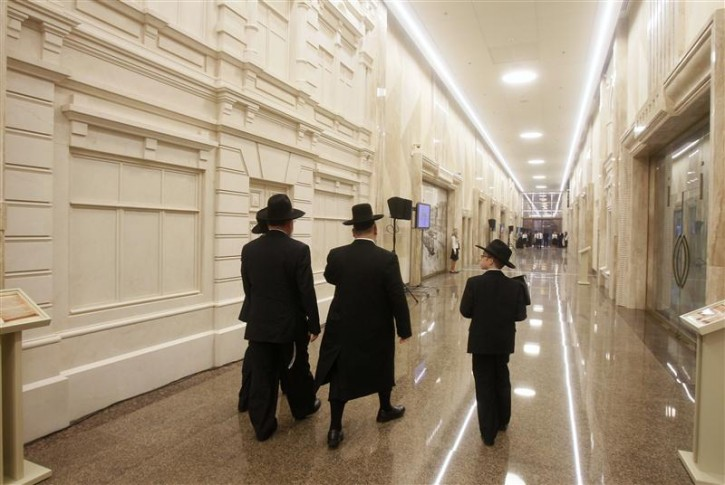 Visitors walk inside the opened Jewish Menorah Center in Dnipropetrovsk October 16, 2012. The Menorah Center is not only the world's biggest Jewish center but also Eastern Europe's biggest holocaust museum, according to the organizers.  REUTERS/Gleb Garanich