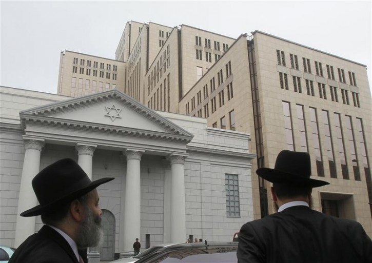 Visitors arrive at the newly opened Jewish Menorah Center in Dnipropetrovsk October 16, 2012. The Menorah Center is not only the world's biggest Jewish center but also Eastern Europe's biggest holocaust museum, according to the organizers.  REUTERS/Gleb Garanich
