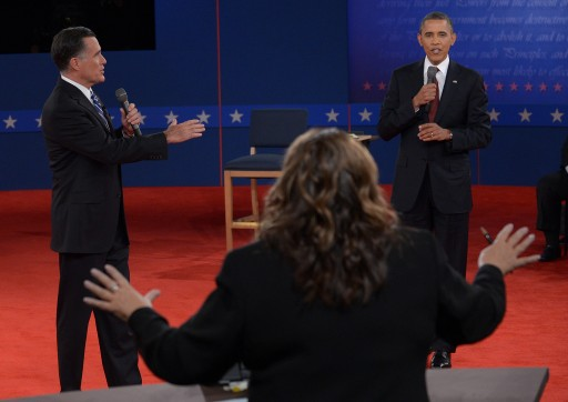 US President Barack Obama (R) and  Republican presidential candidate Mitt Romney (L) both speak as moderator Candy Crowley of CNN (C) tries to control the order of speaking during the presidential debate at Hofstra University in Hempstead, New York, USA, 16 October  2012.  EPA