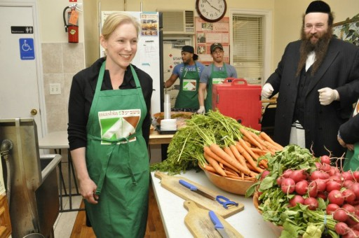 In this June 3 2012 photo NY Sen. Kirsten Gillibrand helping at Kosher Food Organization Masbia