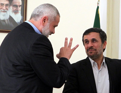 FILE - Iranian president Mahmoud Ahmadinejad (R) talks to the prime minister of the Gaza strip and leading member of the Hamas movement, Ismail Haniyeh at the presidential office in Tehran, Iran, 12 February 2012. EPA