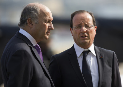FILE - French President Francois Hollande (R)speaks with French Foreign Affairs Minister Laurent Fabius 05 October 2012.