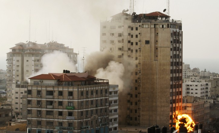 Smoke and fire are seen from an explosion by a high rise housing media organizations in Gaza City, Monday, Nov. 19, 2012. (AP Photo/Hatem Moussa)