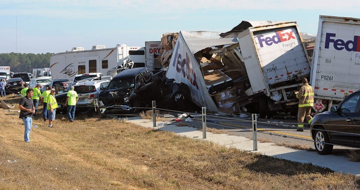 Cars and Trucks are piled on Interstate 10 in Southeast Texas Thursday Nov. 22, 2012. (AP Photo/The Beaumont Enterprise, Guiseppe Barranco)