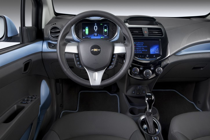 This undated image provided by General Motors shows the 2014 Chevrolet Spark EV,which will be unveiled at the 2012 Los Angles Auto Show during the week of Nov. 26, 2012. With two re-configurable, HD, seven inch color LCD screens, the Spark EV features a customizable interface. (AP Photo/General Motors)