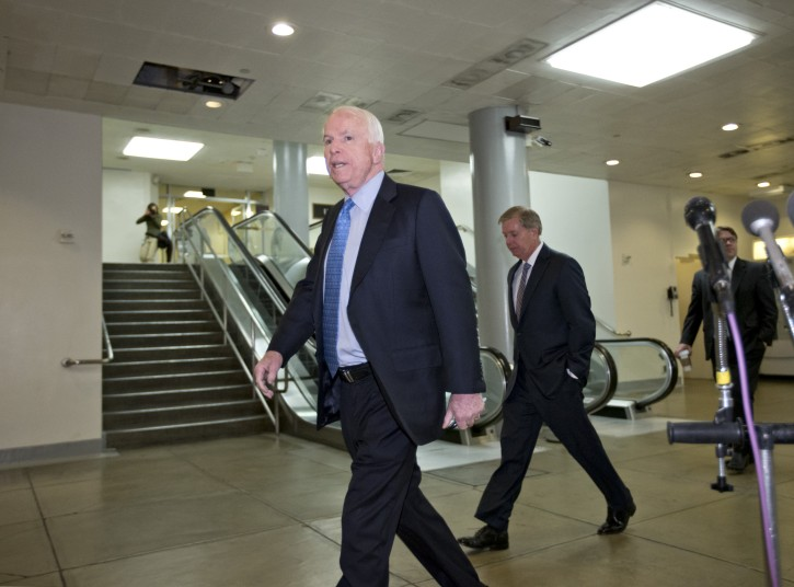 Sen. John McCain, R-Ariz., the ranking member of the Senate Armed Services Committee, left, followed by Sen. Lindsey Graham, R-S.C., right, arrives on Capitol Hill in Washington, Tuesday, Nov. 27, 2012, for a closed-door meeting with U.N. Ambassador Susan Rice who could find her name in contention as early as this week to succeed Hillary Rodham Clinton as secretary of state. McCain and Graham have been vocal opponents of Rice based on her comments following the deadly Sept. 11 attack on a U.S. consulate in Libya. (AP Photo/J. Scott Applewhite)