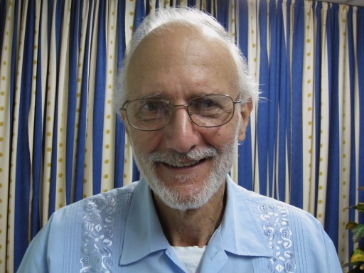In this photo provided by James L. Berenthal, jailed American Alan Gross poses for a photo at Finlay military hospital in Havana, Cuba, Tuesday, Nov. 27, 2012. (AP Photo/James L. Berenthal)