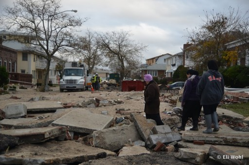 In this Oct 31 2012 photo, Ultra-orthodox Jewish Residents of Sea Gate making their way through a partly destroyed street. The Sea Gate waterfront community suffered heavy damages in the aftermath of Hurricane Sandy. Photo: Eli Wohl/VINNews