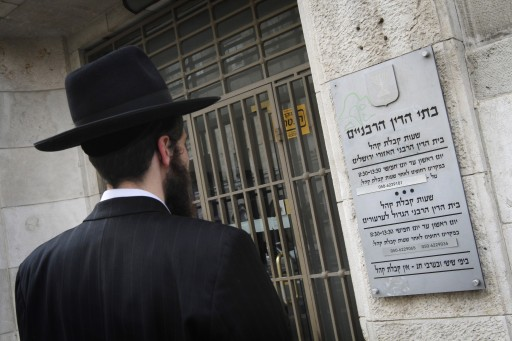 FILE -  Jewish ultra orthodox man stands outside the Rabbinical Court in Jerusalem . FLash90