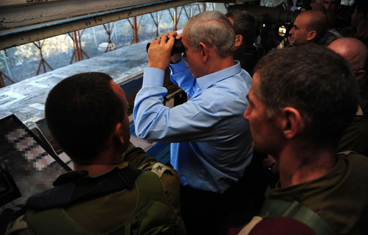 Prime Minister Binyamin Netanyahu and Defense Minister Ehud Barak visit the Golan Heights as they look at the area where the IDF returned fire recently. November 14, 2012.  Photo by Kobi Gideon/GPO/Flash90