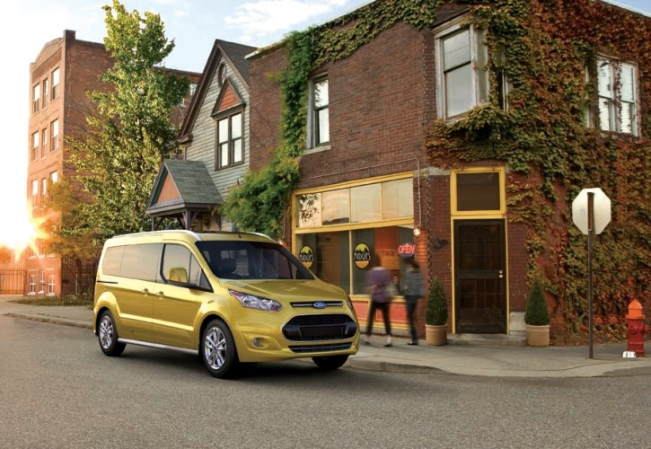 This undated image provided by Ford shows the Transit Connect Wagon. To the average buyer, or, in fact, to everyone outside of Ford Motor Co., the Transit Connect Wagon is Ford's first minivan after a six-year hiatus, but the Transit Connect Wagon, which is based on Ford's Transit Connect commercial van, has the high roof of the van but trades its industrial-looking hood for the tapered nose and trapezoid grille of Ford's cars.  (AP Photo/Ford, Steve Petrovich)