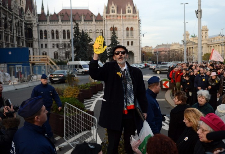 Demonstrators wearing yellow stars as they protest against the speech held by Marton Gyongyosi, a deputy of the far-right Jobbik party on Monday, Nov., 26, in front of the Parliament building in Budapest, Hungary, Tuesday, Nov., 27, 2012. The demonstration was organized by the March of The Living Foundation. (AP Photo/MTI, Tamas Kovacs) Demonstrators wearing yellow stars as they protest against the speech held by Marton Gyongyosi, a deputy of the far-right Jobbik party on Monday, Nov., 26, in front of the Parliament building in Budapest, Hungary, Tuesday, Nov., 27, 2012. The demonstration was organized by the March of The Living Foundation. (AP Photo/MTI, Tamas Kovacs)