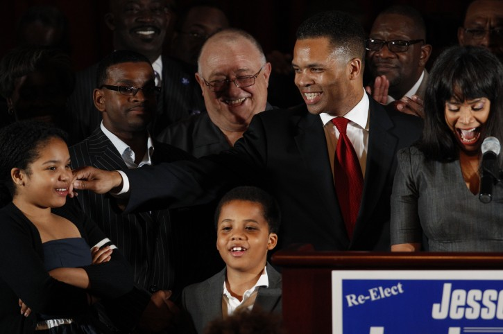This March 20, 2012 file photo shows Rep. Jesse Jackson Jr., D-Ill., his wife Chicago Alderman Sandi Jackson, and their children Jessica, 12, and Jesse III, 8, thanking supporters at his election night party in Chicago after his Democratic primary win over challenger, former Rep. Debbie Halvorson, in the Illinois' 2nd District. (AP Photo/M. Spencer Green, File)