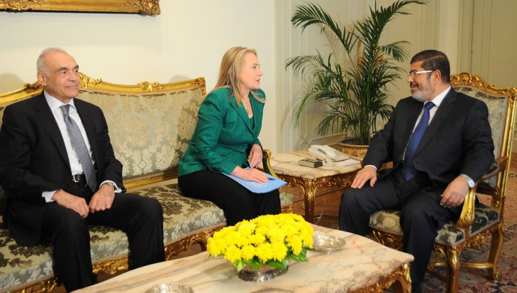 In this photo released by the Egyptian Presidency, U.S. Secretary of State Hillary Rodham Clinton, center, meets with Egyptian President Mohammed Morsi, right, and Egyptian Foreign Minister Mohammed Kamel Amr, left, in Cairo, Egypt, Wednesday, Nov. 21, 2012. (AP Photo/Egyptian Presidency)