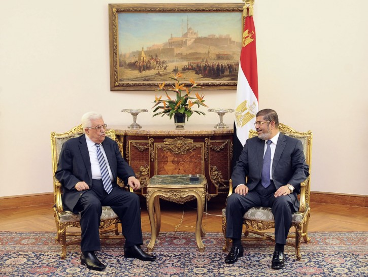 Palestinian President Mahmoud Abbas, left, meets with Egyptian President Mohammed Morsi, right, in Cairo Egypt, Tuesday, Nov. 13, 2012. Morsi expressed his