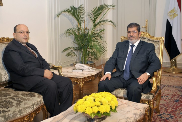 In this photo released by the Egyptian Presidency, President Mohammed Morsi, right, poses for a photograph with his new Prosecutor General, Talaat Abdullah, left, in Cairo, Egypt, Thursday, Nov. 22, 2012. (AP Photo/Egyptian Presidency)