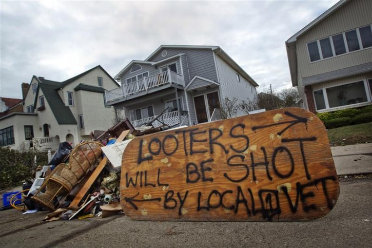 A sign is seen outside a home in Long Beach, New York November 2, 2012, warning looters will be shot.  REUTERS/Shannon Stapleton