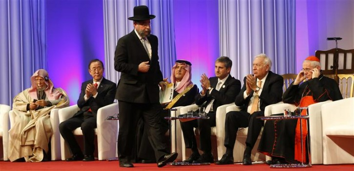 Rabbi Pinchas Goldschmidt walks next to Abdullah Al Turki, President of the Islamic League, U.N. Secretary-General Ban Ki-moon, Saudi Arabian Foreign Minister Prince Saud al-Faisal, Austrian Foreign Minister Michael Spindelegger, Spanish Foreign Minister Manuel Garcia-Margallo y Marfil and Cardinal Jean-Luis Tauran (L-R), during the opening ceremony of the 'King Abdullah Bin Abdulaziz International Center for Interreligious and Intercultural Dialogue' (KAICIID) in Vienna November 26, 2012. REUTERS/Leonhard Foeger