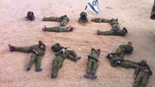 Soldiers use their bodies to spell in Hebrew' Bibi [is a] loser' Thursday (photo credit: screen capture/Facebook)