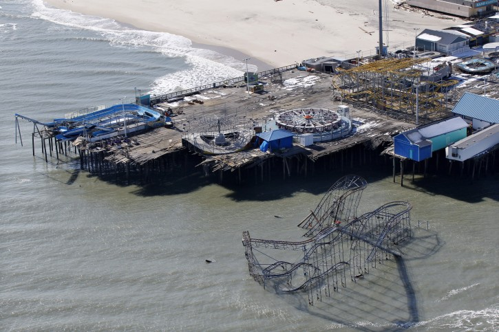 FILE - In this Friday, Nov. 9, 2012 file photograph, the roller coaster from an amusement pier rests in the Atlantic Ocean in Seaside Heights, N.J., after the region was pounded by Superstorm Sandy. The remains of the roller coaster that was knocked off a New Jersey amusement pier by Superstorm Sandy and partially submerged in the Atlantic Ocean might be left there as a tourist attraction. (AP Photo/Mel Evans)