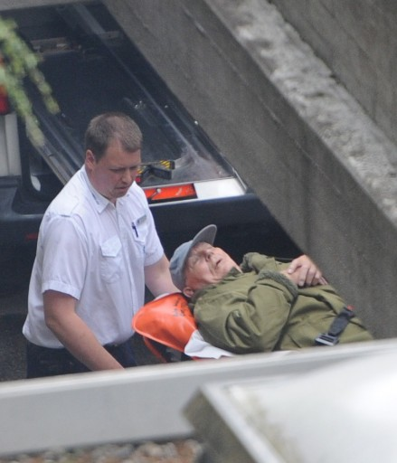 File phot of former concentration camp guard John Demjanjuk is taken out of the Land court's court-room on a stretcher in Munich, Germany, 12 May 2011. EPA/MARC MUELLER