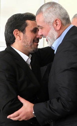 File photo of  Iranian president Mahmoud Ahmadinejad (L) welcomes the prime minister of the Gaza strip and leading member of the Hamas movement, Ismail Haniyeh (R) at the presidential office in Tehran, Iran, 12 February 2012. EPA/ABEDIN TAHERKENAREH