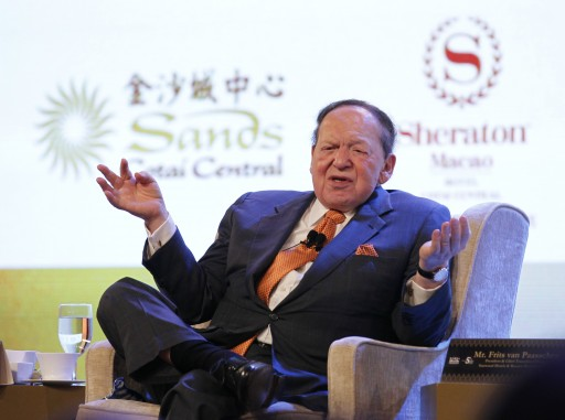 File - American Sheldon G. Adelson (L), Chairman and CEO of the Las Vegas Sands Corporation, speaks at a press conference for the Opening Ceremony of the Sheraton Macao at Catai Central in Macao SAR, China, 20 September 2012.  EPA/David G. McIntyre