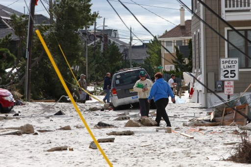 FILE - Residents asses the damage to their homes and cars in Normandy Beach, New Jersey, USA, 31 October 2012. EPA