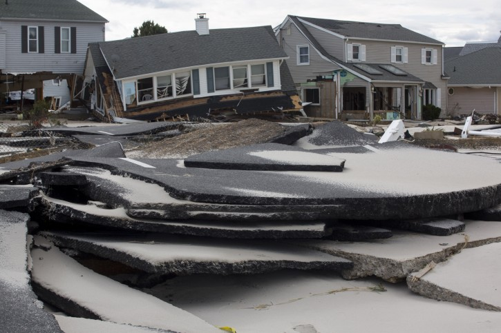 A handout image released 03 November 2012 by the American Red Cross showing extensive damage to an asphalt roadway in New Jersey, USA, 02 November 2012. EPA/LES STONE/ AMERICAN RED CROSS