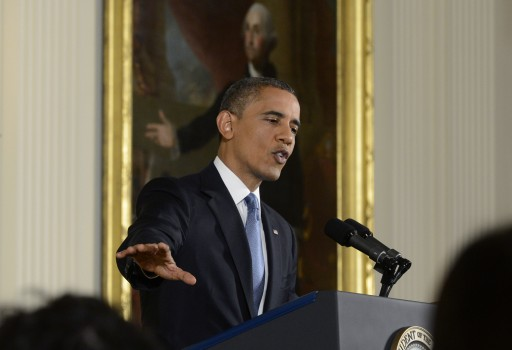 US President Barack Obama responds to a question from a member of the news media during a news conference in the East Room of the White House in Washington DC, USA, 14 November 2012. The painting in the background is a portrait of George Washington.  EPA/MICHAEL REYNOLDS