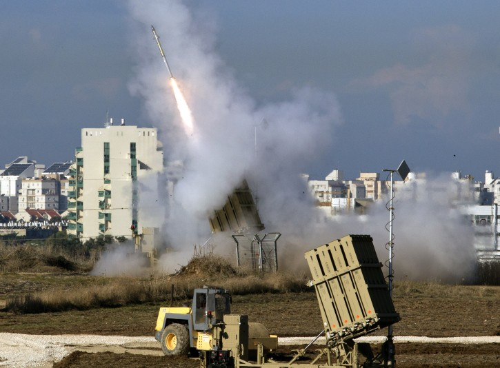 An Israeli 'Iron Dome' fires a missile to intercept Grad missiles fired from the Gaza Strip, as it defends an Israeli population center in the south of the country, 15 November 2012. EPA/JIM HOLLANDER