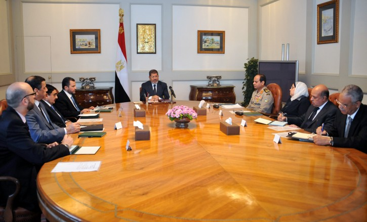 Egyptian President Mohamed Morsi (C) meeting with Egyptian Defence Minister Abdelfattah Said El-Sisi (4-R), Prime Minister Hisham Qandil (4-L) and other officials to discuss Gaza developments, in Cairo, Egypt, 15 November 2012. EPA/EGYPTIAN PRESIDENCY/HANDOUT