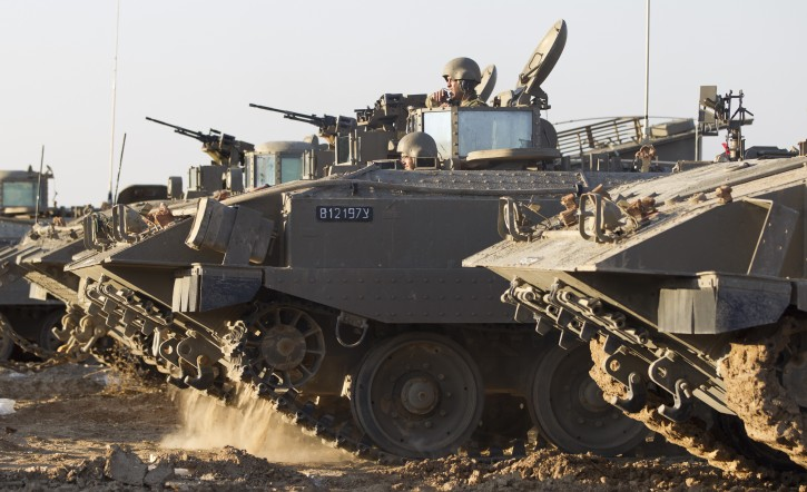Israeli APCs leave from a base in Kissufim, next to the border with the Gaza Strip, southern Israel, 15 November 2012.  EPA