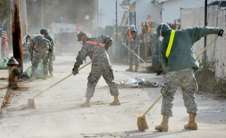 National Guard troops work on cleaning a street as people continue to try and recover from the aftermath of Hurricane Sandy in the New Dorp neighborhood of Staten Island, New York, USA, 15 November 2012. Many communities in the area are still working on clean up from the flooding caused by the storm surge and are without power.  EPA/JUSTIN LANE