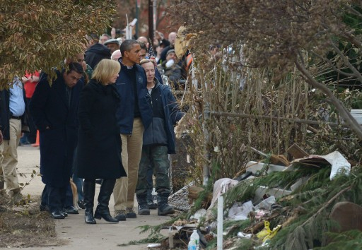 FILE - President Barack Obama (C) looks over damage from Hurricane Sandy with residents in the New Dorp neighborhood of Staten Island, New York, USA, 15 November 2012. EPA
