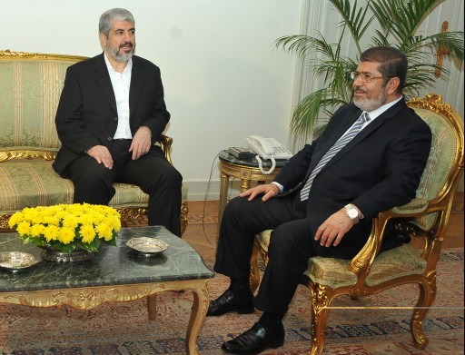 A handout picture released by the Egyptian Presidency shows Egyptian President Mohamed Morsi (R) meeting with Khaled Mashaal, the head of the Political Bureau of Hamas (L), in Cairo, Egypt, 18 November 2012.  EPA