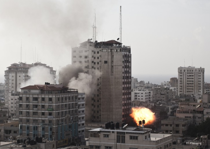 A fireball rises from the Al Shoroq building, which was hosting an office of Hamas TV, after an Israeli air strike in Gaza city, 19 November 2012. EPA/OLIVER WEIKEN