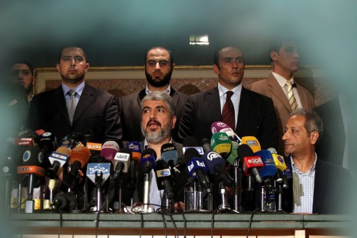 Khaled Mashaal, the head of the Political Bureau of Hamas (C), speaks during a press conference in Cairo, Egypt, 19 November 2012. EPA