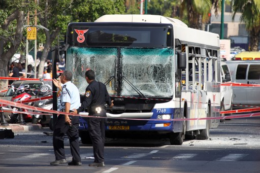 Israeli police and rescue personnel at the scene of the bus bombing in central Tel Aviv, 21 November 2012.