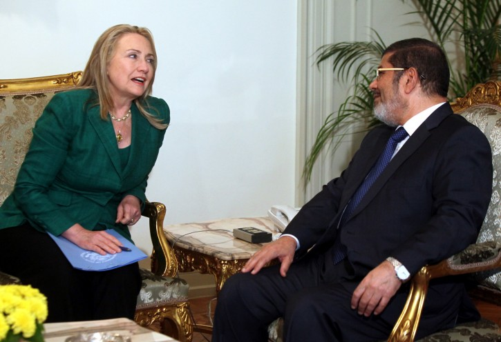 Egyptian President Mohamed Morsi (R) meets with US Secretary of State Hillary Rodham Clinton (L), in Cairo, Egypt, 21 November 2012. Clinton, who is in the region to push for a ceasefire between Israel and the Palestinians, met earlier with Israeli Prime Minister Benjamin Netanyahu and held talks with Palestinian President Mahmoud Abbas in the West Bank city of Ramallah.  EPA/KHALED ELFIQI