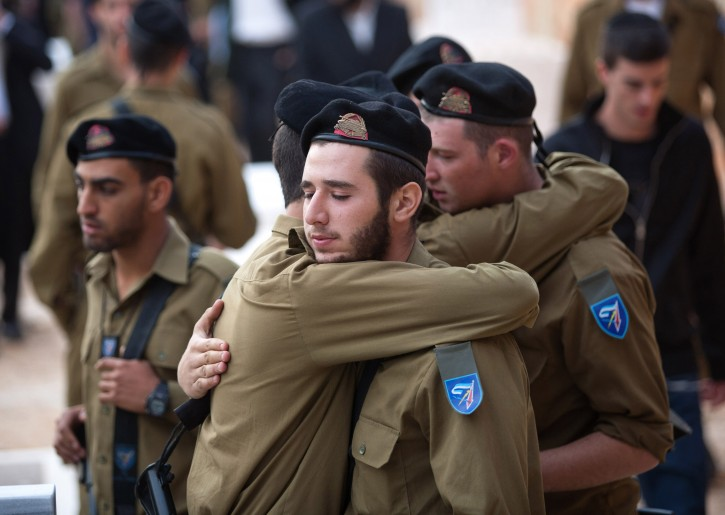 Soldiers mourn near the grave of Yosef Nachman Partok during his funeral in Jerusalem, Israel, 21 November 2012. Partok was killed on 20 November when a mortar fired by Palestinian militants in the Gaza Strip exploded in southern Israel.  EPA/MIHAL FATTAL