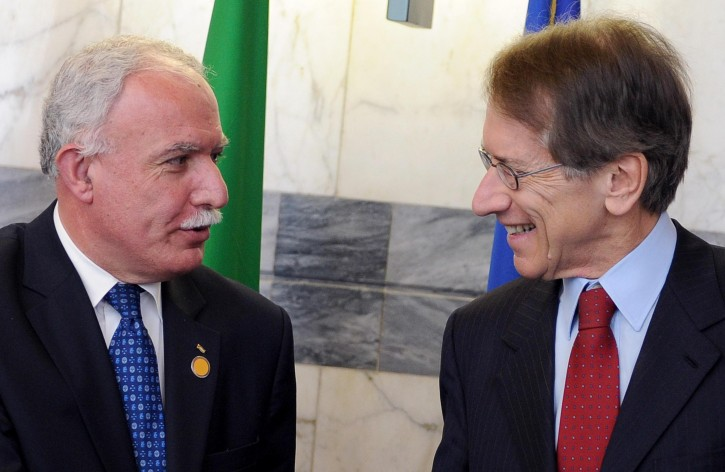 Italian Foreign Minister, Giulio Terzi (R), welcomes Foreign Minister of the Palestinian National Authority, Riad Malki (L), during their meeting at the Farnesina palace in Rome, Italy, 23 November 2012. EPA/ETTORE FERRARI